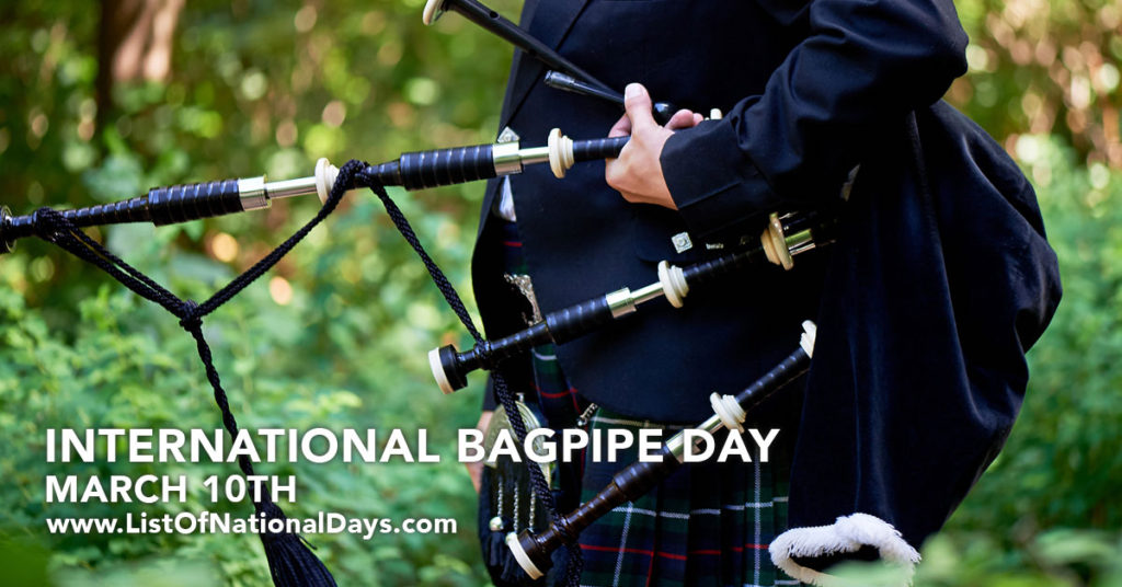 Man holding a bagpipe