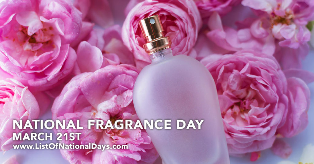 A perfume bottle laying on pink roses