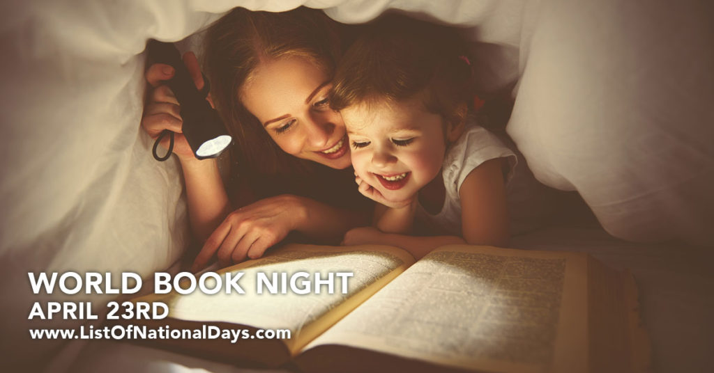 Mother and daughter reading under the covers with a flashlight.