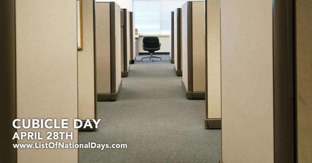 Looking down an aisle of cubicles.