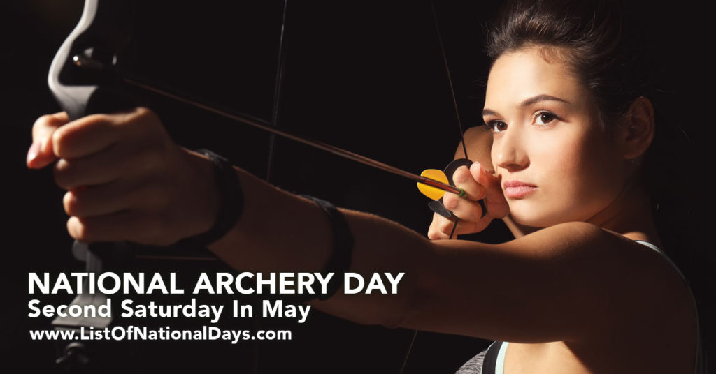 woman  archer aiming down range.