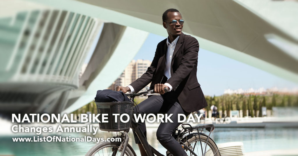 A man in a suit biking to work.