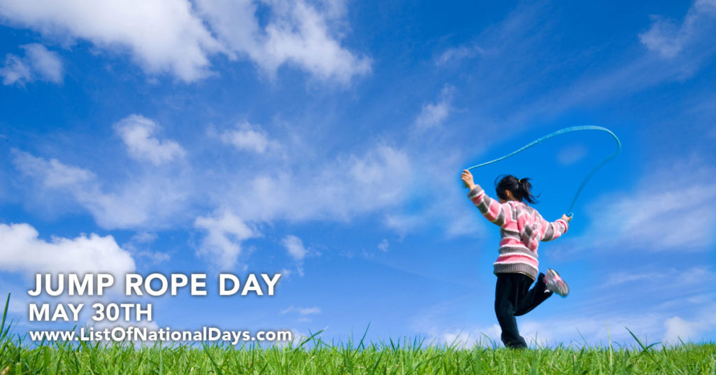 A girl skipping rope in a field.