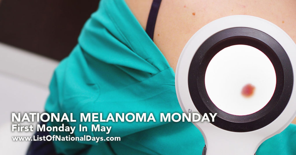 A doctor examine a patients back for melanoma.