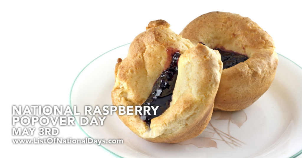 Two raspberry popovers on a plant.