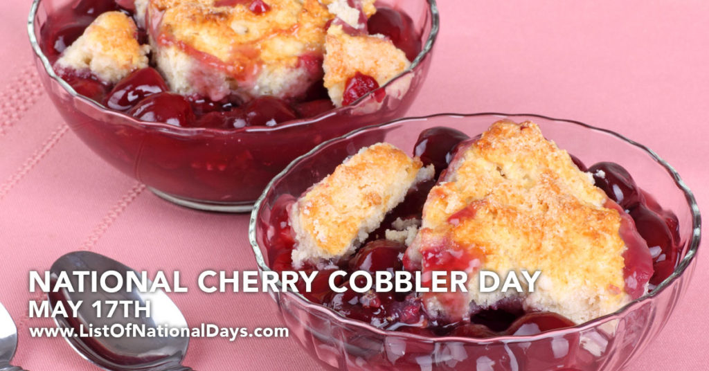 Two bowls of cherry cobbler on a pink table.