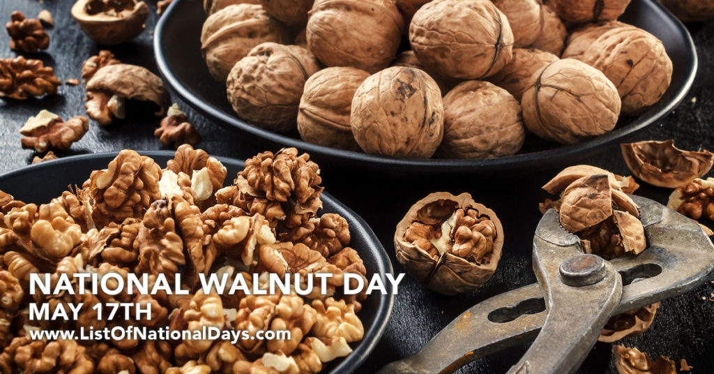 A bowl of walnuts next to a bowl of cracked walnuts.