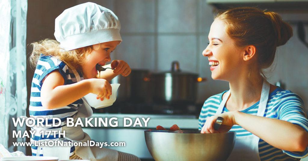 A mother and daughter wearing matching striped shirts  having fun baking.