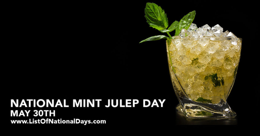 A glass of Mint Julep on a black background.