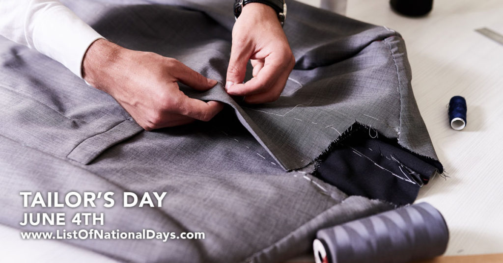 A tailors hands sewing a bespoke suit.
