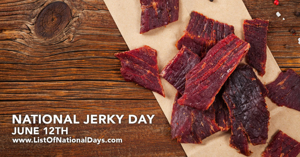 Pieces of jerky on a wooden table.