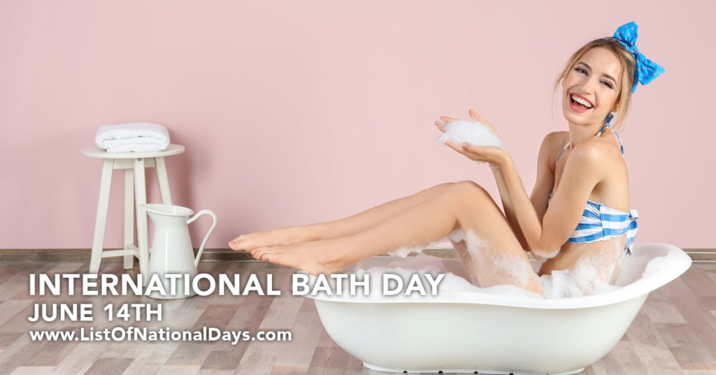 A young woman in a blue and white stripped bikini sitting in a very small bathtub.