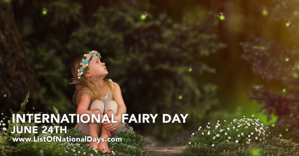 A young girl sitting in a forest looking at tiny fairies that could be fireflies.