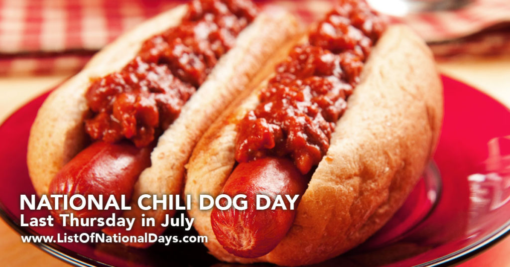 Two chili dogs on a red plate.