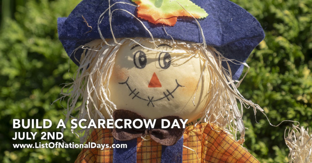 A smiling scarecrow with a blue hat and straw hair.