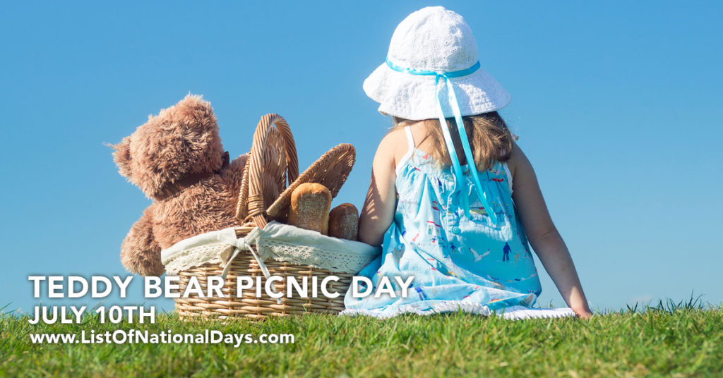 A teddy bear sitting in a picnic basket with a young girl in a grassy park.