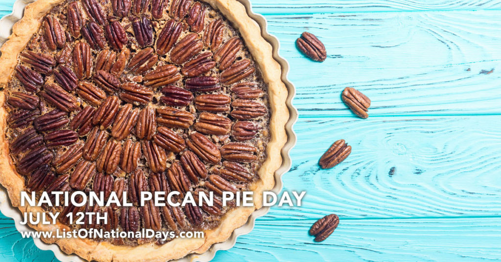 A pecan pie on a turquoise wooden table.