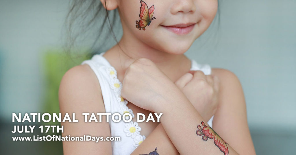 young girl with fake butterfly tattoo on her cheek.