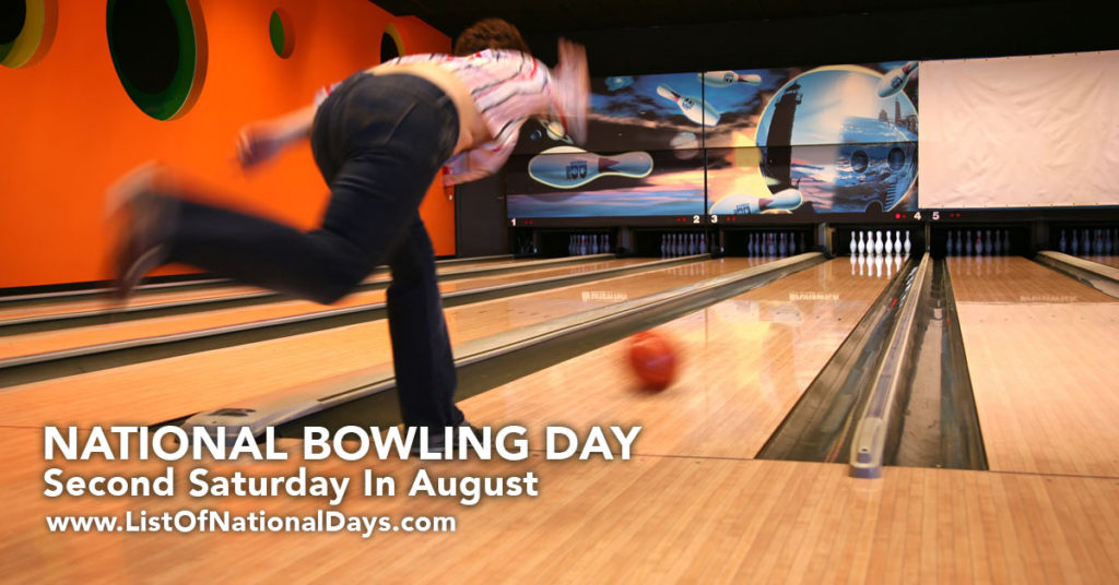 A bowling ball rolling down the alley right after it has been thrown.
